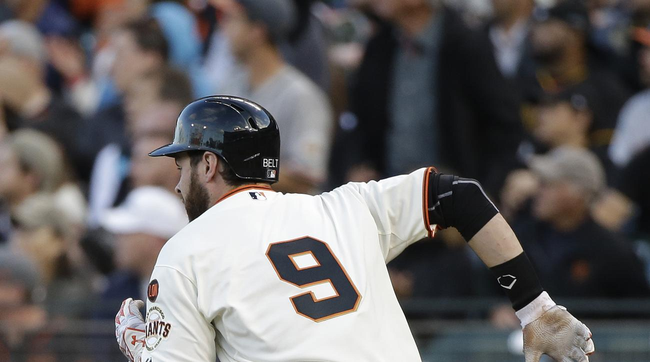 San Francisco Giants' Brandon Belt runs toward first base after hitting a two RBI double to right field against Pittsburgh Pirates starting pitcher Gerrit Cole in the first inning of their baseball game Monday, June 1, 2015, in San Francisco. (AP Photo/Er