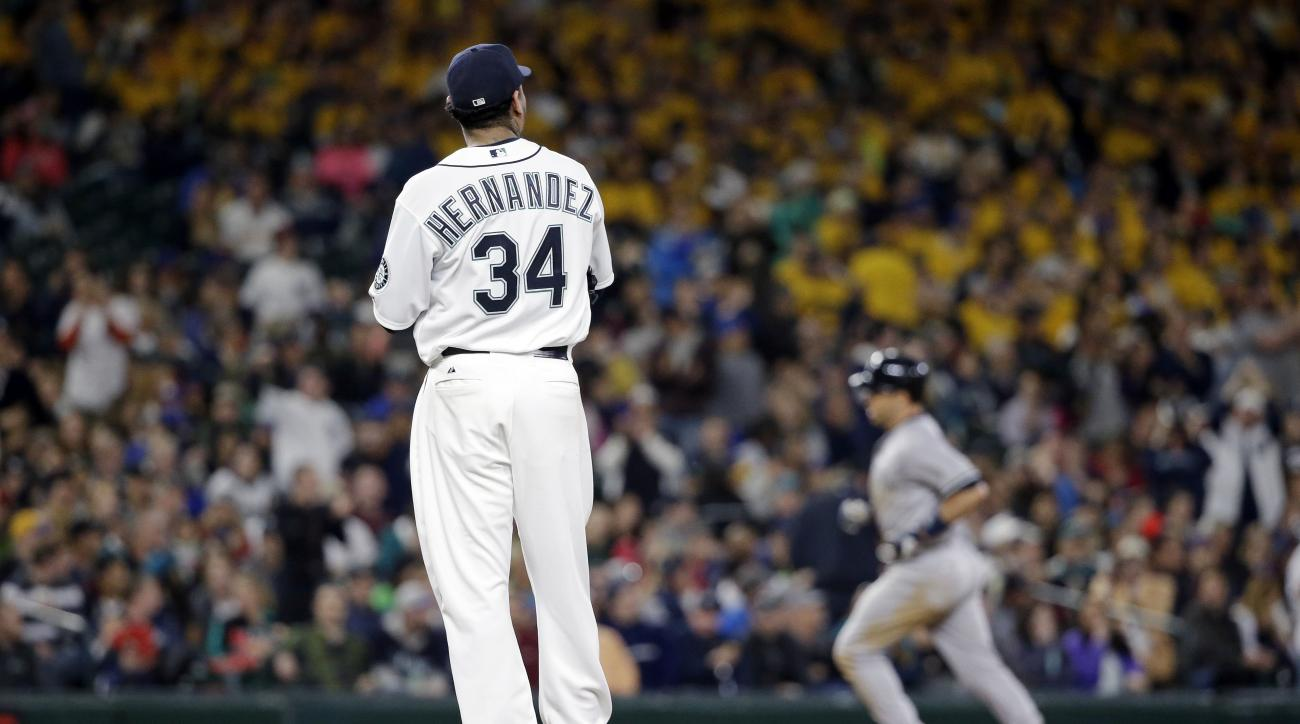 Seattle Mariners starting pitcher Felix Hernandez (34) watches as New York Yankees' Mark Teixeira rounds the bases on a grand slam in the fifth inning of a baseball game Monday, June 1, 2015, in Seattle. (AP Photo/Elaine Thompson)