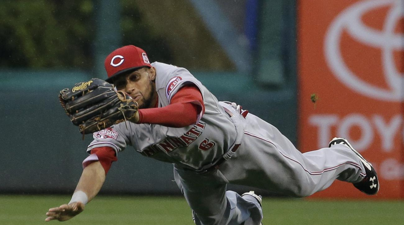 Cincinnati Reds center fielder Billy Hamilton catches a line out by Philadelphia Phillies' Ben Revere during the first inning of a baseball game, Tuesday, June 2, 2015, in Philadelphia. (AP Photo/Matt Slocum)