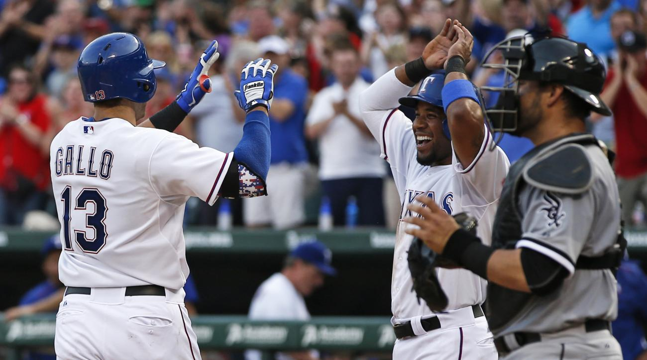 Texas Rangers' Joey Gallo (13) is congratulated by Elvis Andrus, center, as Chicago White Sox catcher Geovany Soto, right, watches following Gallo's two-run home run against the Chicago White Sox during the third inning of a baseball game, Tuesday, June 2