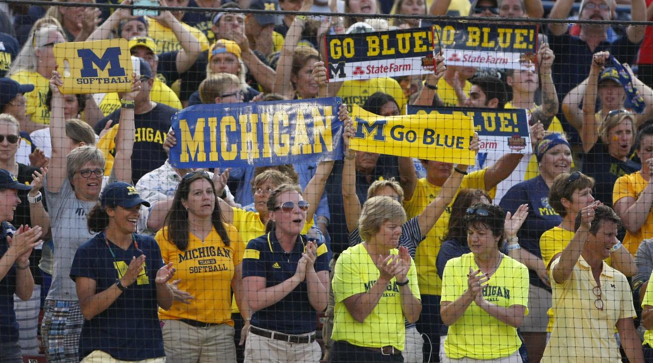 Michigan fans cheer on their team against Florida during the seventh inning of Game 2 of the finals in the NCAA softball Women's College World Series, Tuesday, June 2, 2015, in Oklahoma City. Michigan won 1-0, forcing a deciding third game. (AP Photo/Alon