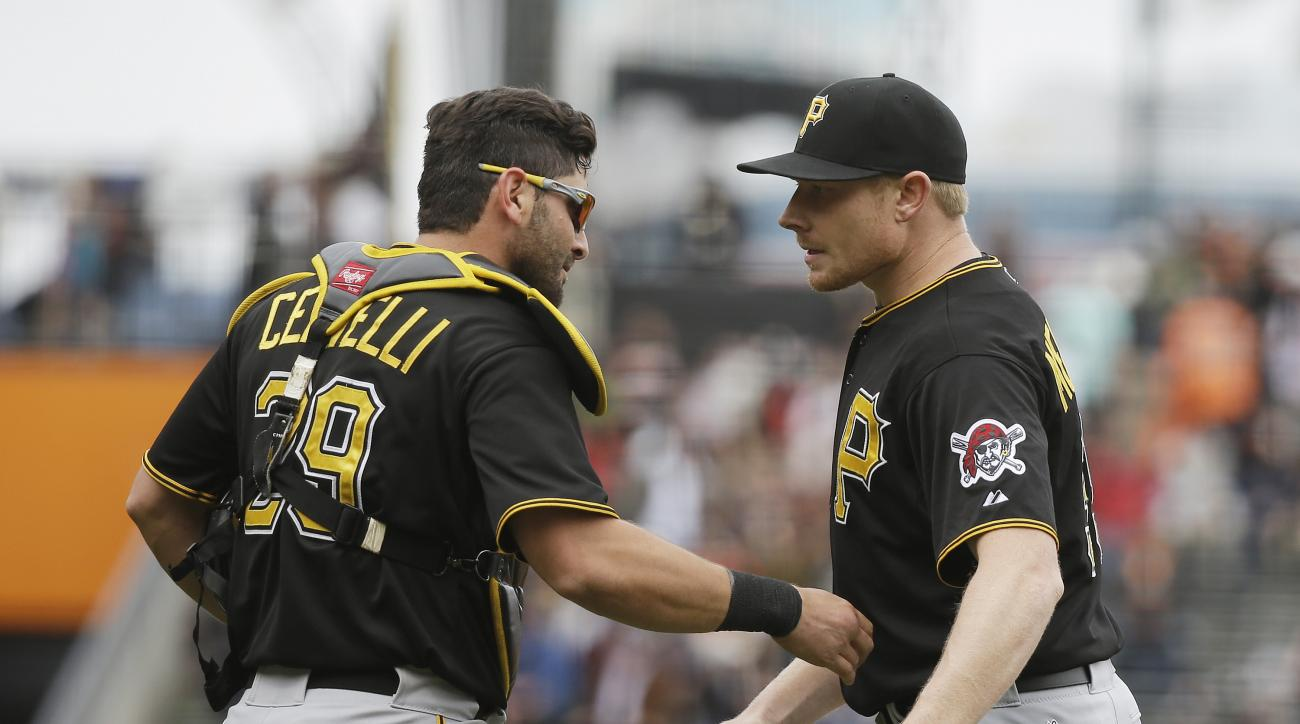 Pittsburgh Pirates relief pitcher Mark Melancon, right, is greeted by catcher Francisco Cervelli, left, at the end of their baseball game against the San Francisco Giants Wednesday, June 3, 2015, in San Francisco. Pittsburgh won the game 5-2. (AP Photo/Er