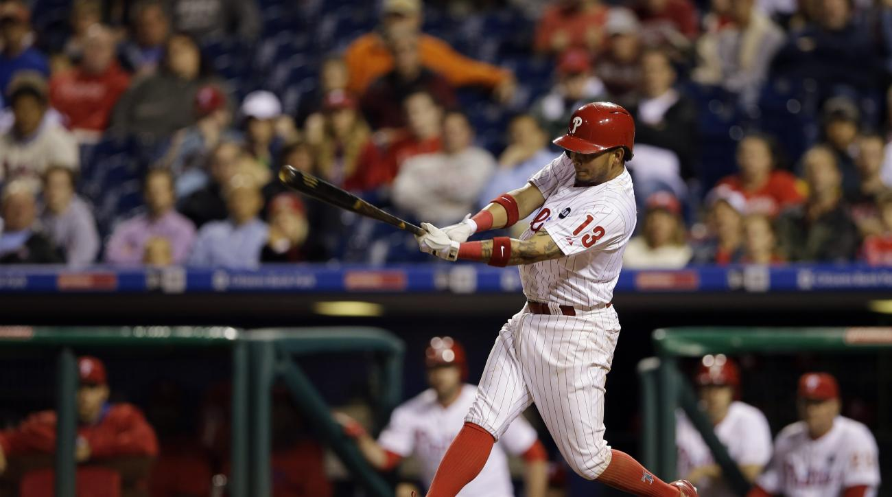Philadelphia Phillies' Freddy Galvis follows through after driving in the game-winning run on a fielding error by Cincinnati Reds relief pitcher Ryan Mattheus during the 11th inning of a baseball game, Wednesday, June 3, 2015, in Philadelphia. Philadelphi