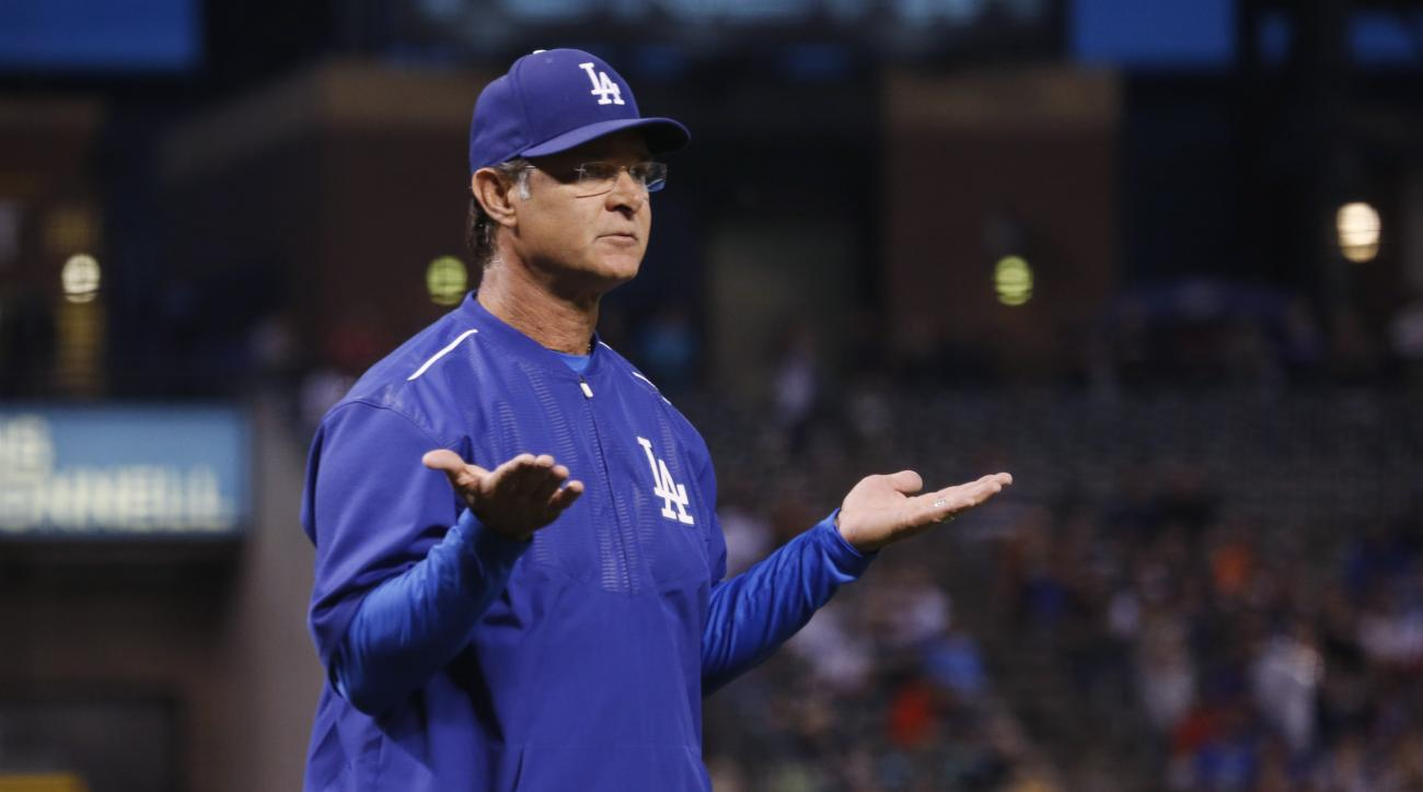 Los Angeles Dodgers manager Don Mattingly asks home plate umpire Jeff Nelson why Colorado Rockies' Charlie Blackmon was allowed to advance to third base in the first inning of a baseball game Wednesday, June 3, 2015, in Denver. Los Angeles Dodgers startin
