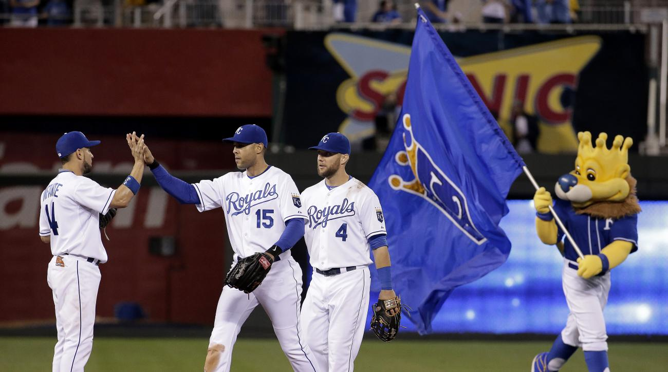 Kansas City Royals' Omar Infante (14), Alex Rios (15) and Alex Gordon (4) celebrate after a baseball game against the Cleveland Indians on Wednesday, June 3, 2015, in Kansas City, Mo. The Royals won 4-2. (AP Photo/Charlie Riedel)