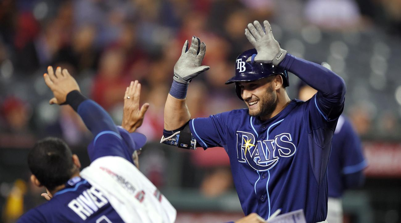 Tampa Bay Rays' Kevin Kiermaier, right, is congratulated by teammates after hitting a solo home run in the 10th inning of a baseball game against the Los Angeles Angels, Wednesday, June 3, 2015, in Anaheim, Calif. (AP Photo/Mark J. Terrill)