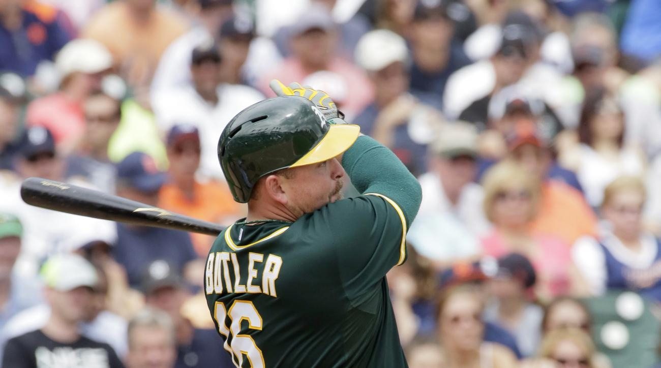 Oakland Athletics' Billy Butler singles to left field to drive in Billy Burns during the fifth inning of a baseball game against the Detroit Tigers at Comerica Park, Thursday, June 4, 2015, in Detroit. Tigers left fielder Daniel Fields fielding error also