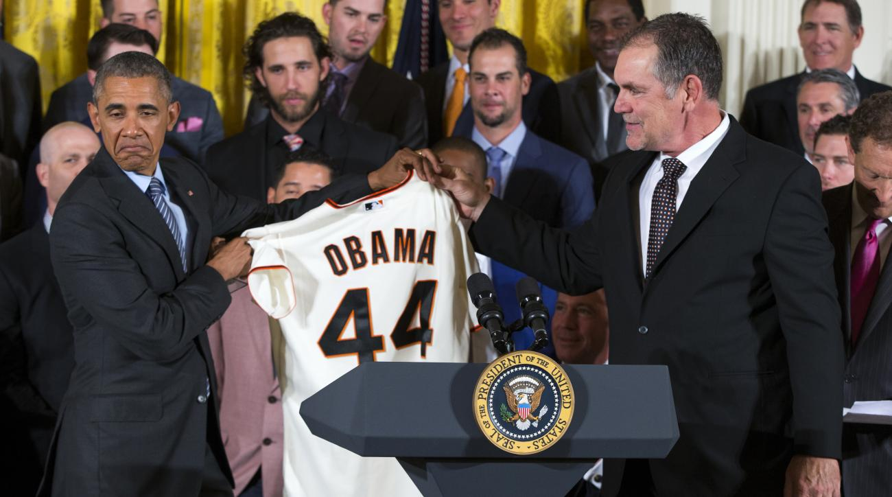 President Barack Obama accepts a personalized San Francisco Giants jersey from manager Bruce Bochy during an event in the East Room of the White House in Washington, Thursday, June 4, 2015, where the president honored the World Series champions.  (AP Phot