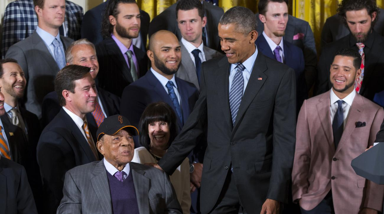 President Barack Obama greets Hall of Fame baseball player Willie Mays during a ceremony in the East Room of the White House in Washington, Thursday, June 4, 2015, where the president honored the 2014 World Series champion San Francisco Giants baseball te