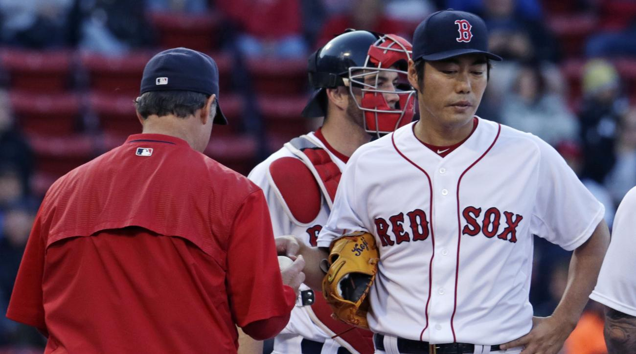 Boston Red Sox relief pitcher Koji Uehara hands the baseball to manager John Farrell as he is taken out in the ninth inning of a baseball game against the Minnesota Twins at Fenway Park on Thursday, June 4, 2015, in Boston. Uehara gave up four runs, with