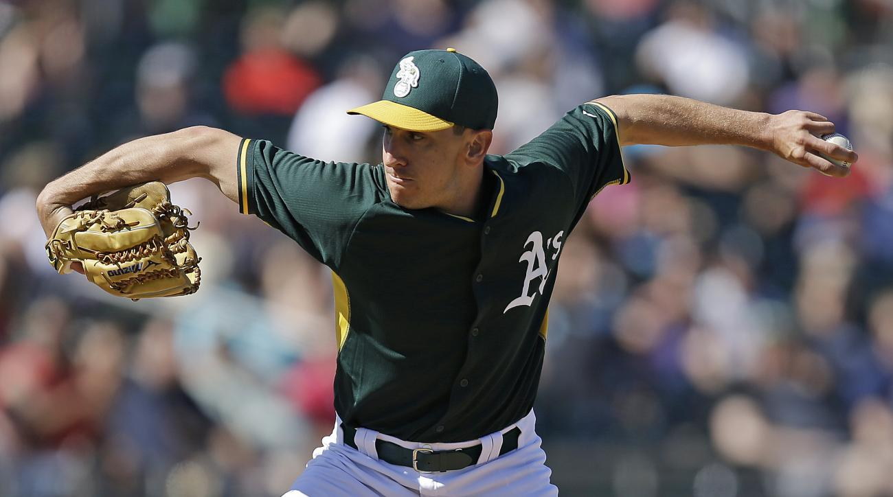 Oakland Athletics' Pat Venditte works against the Chicago White Sox in the fourth inning of a spring training baseball game Sunday, March 8, 2015, in Mesa, Ariz. (AP Photo/Ben Margot)