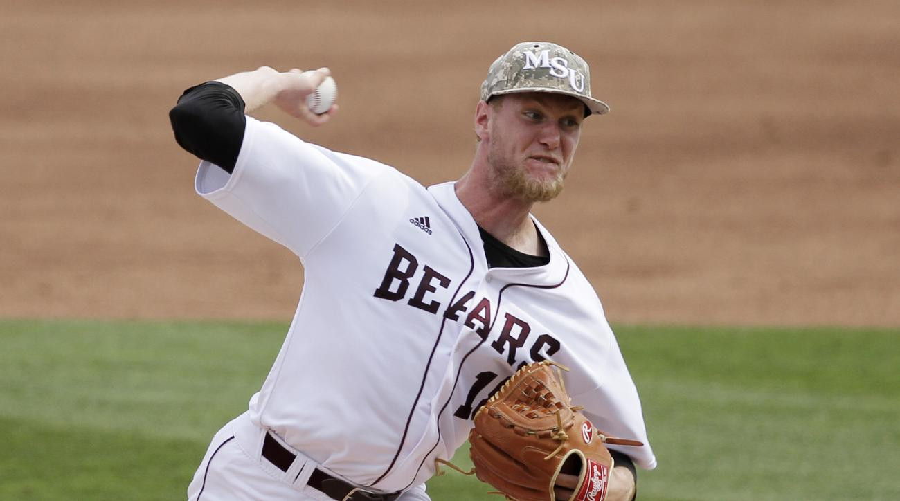 Missouri State pitcher Jon Harris throws against Arkansas during the second inning in a super regional of the NCAA college baseball tournament in Fayetteville, Ark., Friday, June 5, 2015. (AP Photo/Danny Johnston)