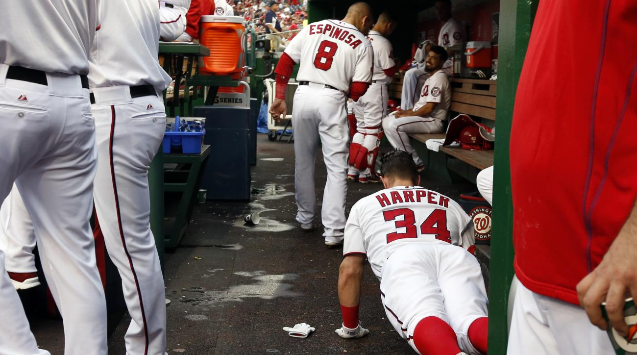 Washington Nationals right fielder Bryce Harper (34) does push ups in the dugout the first inning of a baseball game against the Chicago Cubs at Nationals Park, Friday, June 5, 2015, in Washington. (AP Photo/Alex Brandon)