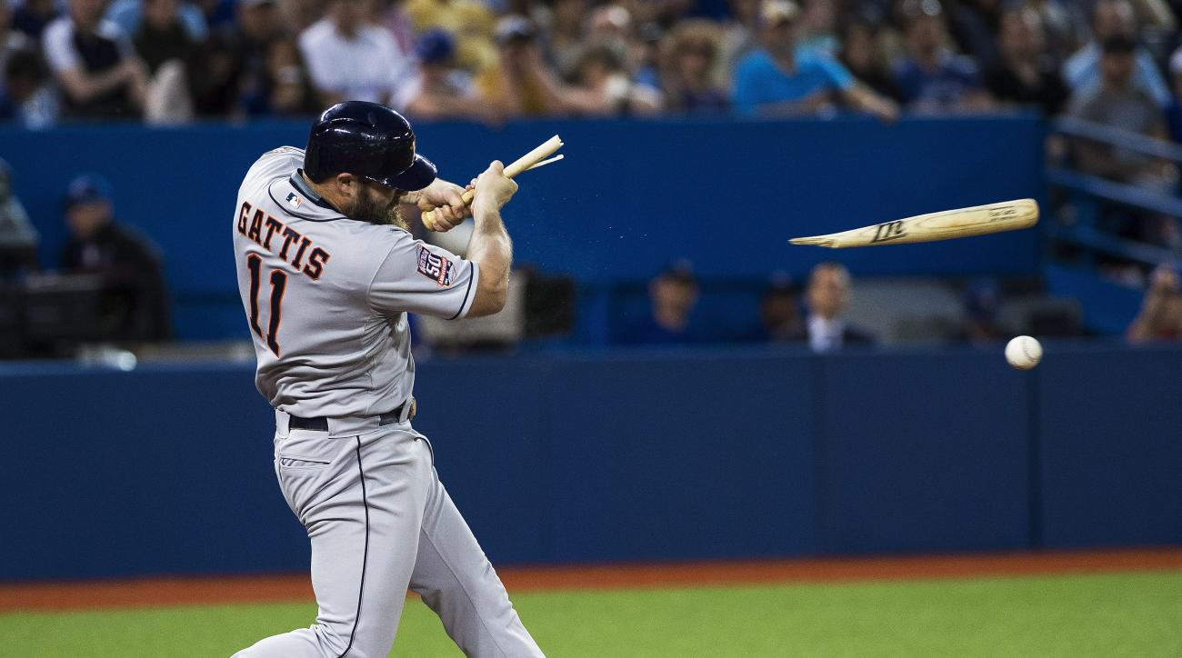 Houston Astros' Evan Gattis breaks his bat against the Toronto Blue Jays during the seventh inning of a baseball game, Friday, June 5, 2015 in Toronto. (Aaron Vincent Elkaim /The Canadian Press via AP) MANDATORY CREDIT