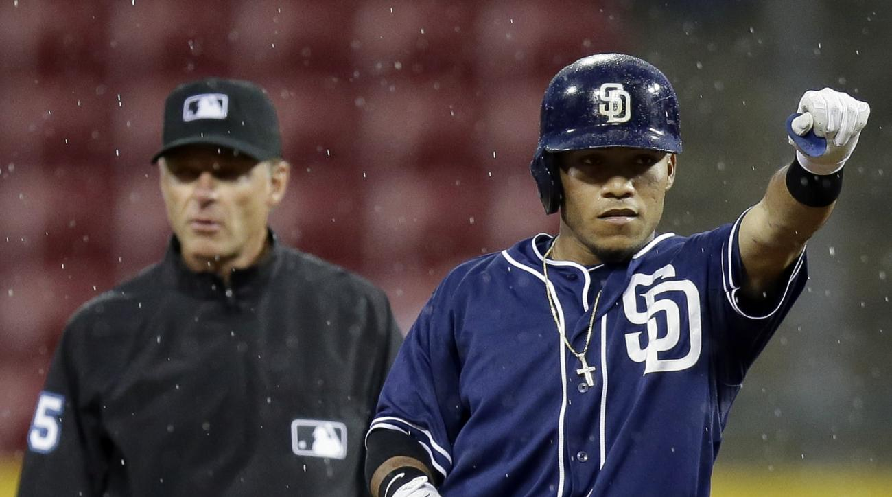 San Diego Padres' Alexi Amarista, right, reacts after hitting a double to deep left off Cincinnati Reds relief pitcher Burke Badenhop to drive home Cory Spangenberg in the sixth inning of a baseball game, Friday, June 5, 2015, in Cincinnati. (AP Photo/Joh