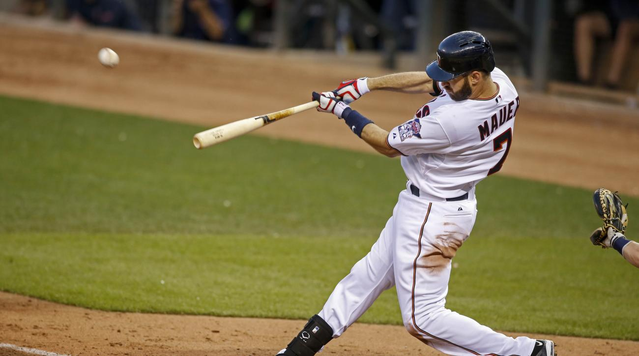 Minnesota Twins first baseman Joe Mauer (7) hits a 3 run home run to tie the game in the 5th inning of a baseball game Friday, June 5, 2015, in Minneapolis. (AP Photo/Bruce Kluckhohn)
