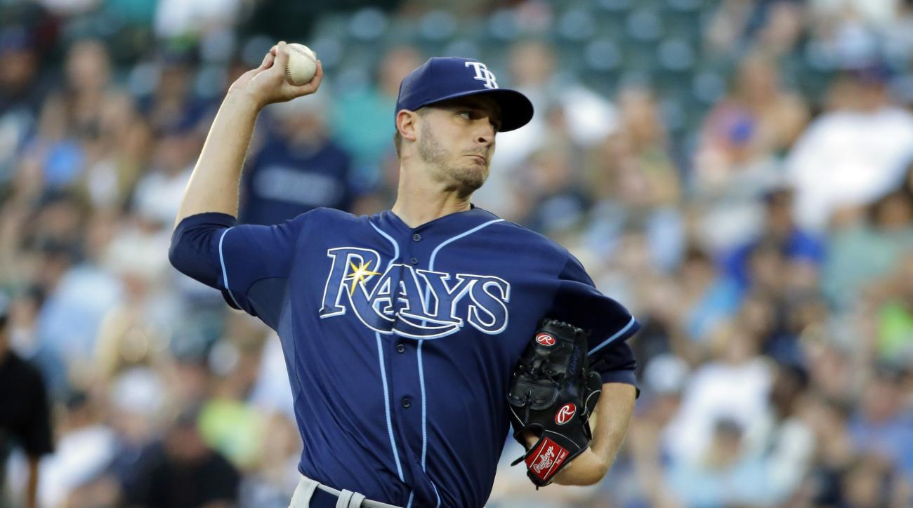 Tampa Bay Rays starting pitcher Jake Odorizzi throws against the Seattle Mariners in the first inning of a baseball game, Friday, June 5, 2015, in Seattle. (AP Photo/Ted S. Warren)