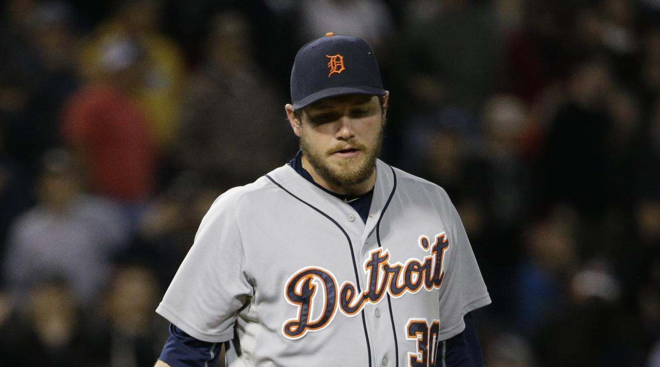 Detroit Tigers relief pitcher Alex Wilson looks down after Chicago White Sox's Alexei Ramirez hit a single during the 11th inning of a baseball game Friday, June 5, 2015, in Chicago. The White Sox won 4-3. (AP Photo/Nam Y. Huh)