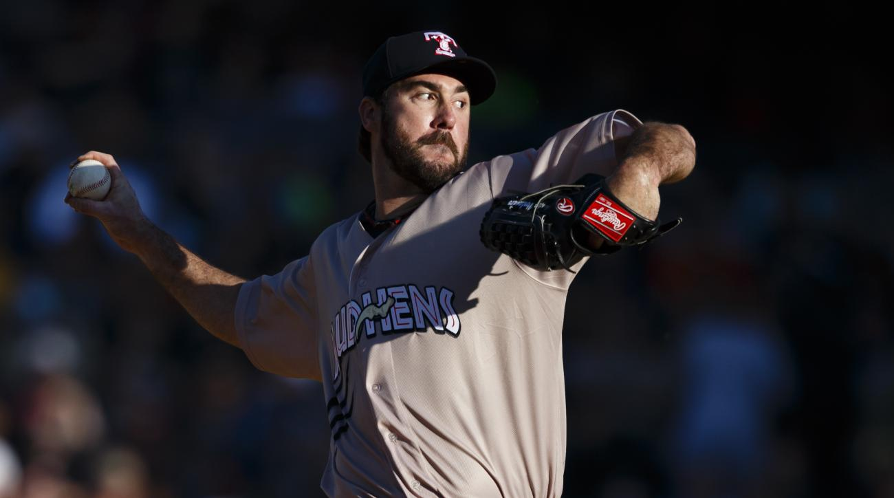 Detroit Tigers pitcher Justin Verlander, playing for the Toledo Mud Hens in a rehab start, delivers in the first inning of a Triple-A baseball game against the Columbus Clippers in Toledo, Ohio, Saturday, June 6, 2015. (AP Photo/Rick Osentoski)