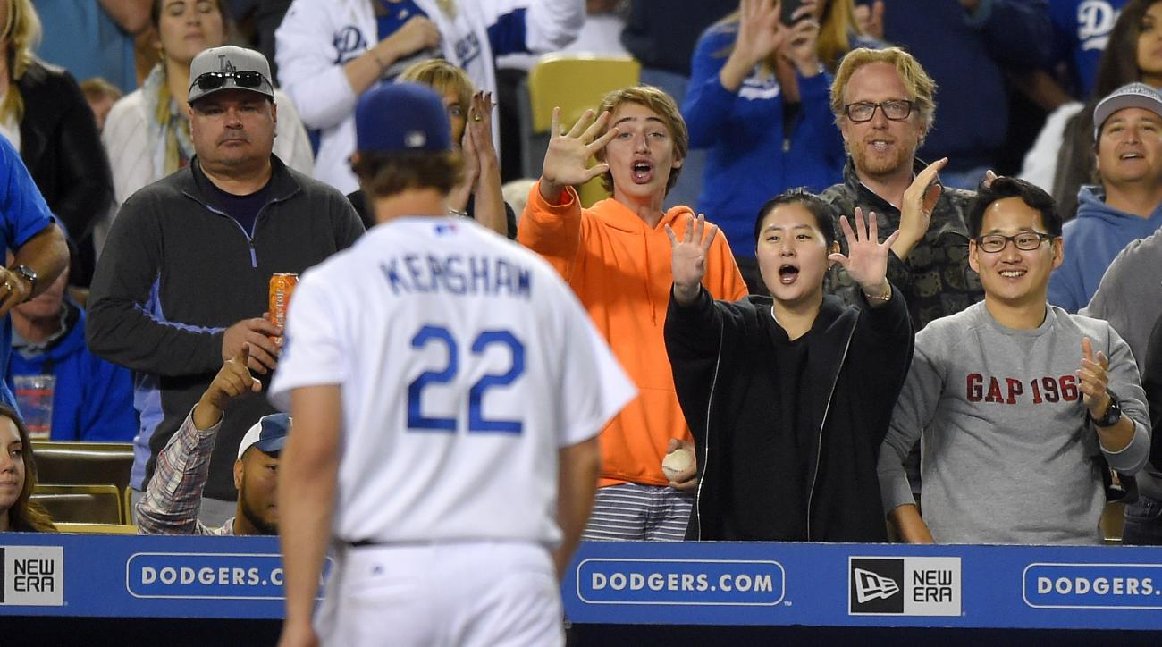 Los Angeles Dodgers starting pitcher Clayton Kershaw walks off the field as fans cheers after the eighth inning of a baseball game against the St. Louis Cardinals, Saturday, June 6, 2015, in Los Angeles. (AP Photo/Mark J. Terrill)