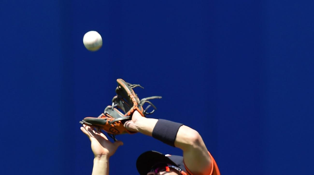Houston Astros second baseman Jose Altuve shields his eyes from the sun as he catches a pop fly against the Toronto Blue Jays during second-inning baseball game action on Sunday, June 7, 2015. (Frank Gunn/The Canadian Press via AP) MANDATORY CREDIT