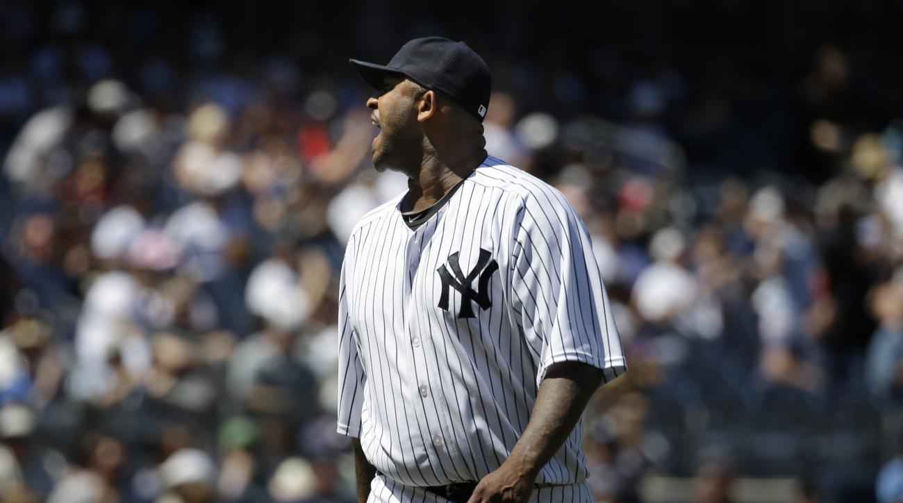 New York Yankees starting pitcher CC Sabathia yells at the home plate umpire during the sixth inning of a baseball game against the Los Angeles Angels, Sunday, June 7, 2015, in New York. Sabathia and manager Joe Girardi were ejected from the game. (AP Pho