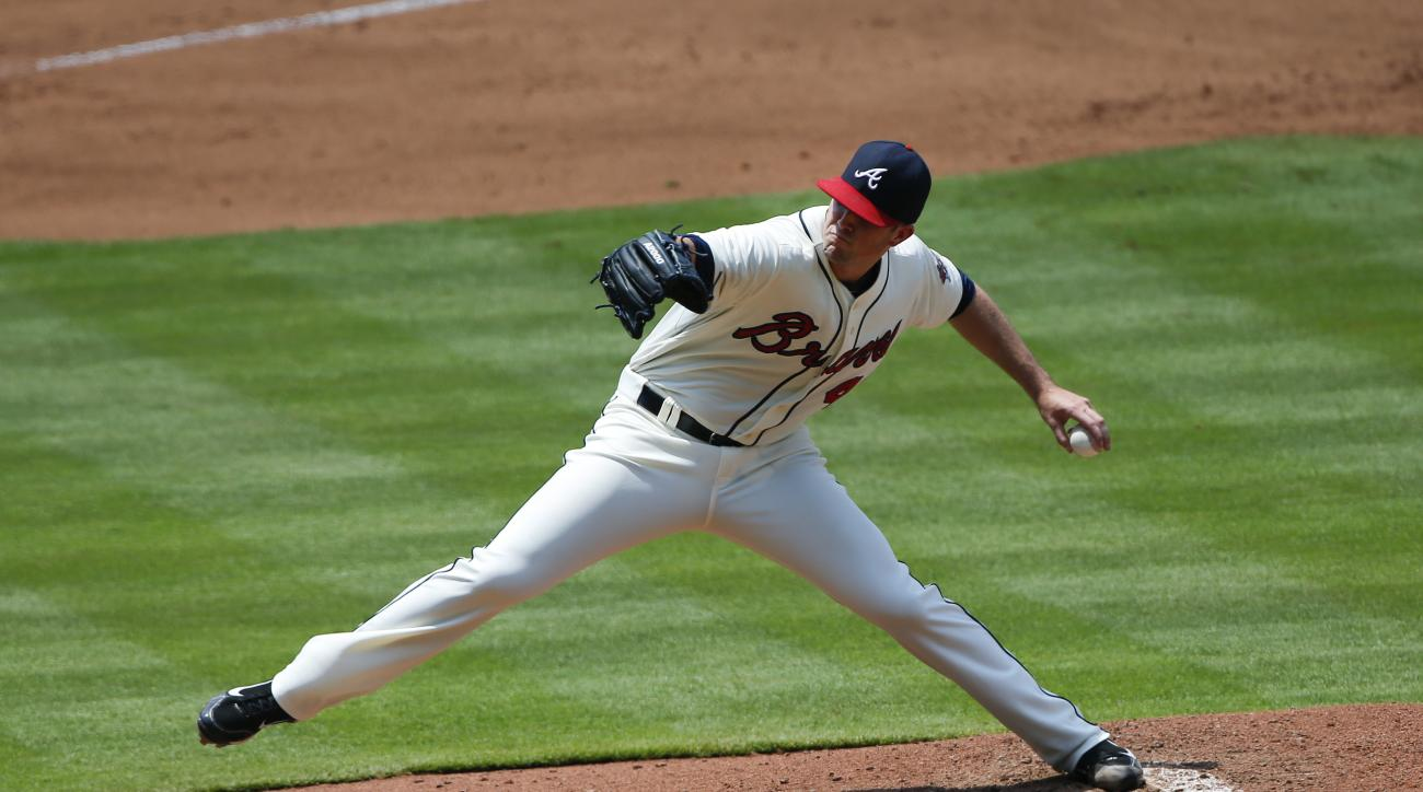 Atlanta Braves starting pitcher Alex Wood works in the fourth inning of a baseball game against the Pittsburgh Pirates, Sunday, June 7, 2015, in Atlanta. (AP Photo/John Bazemore)