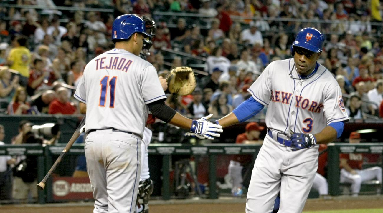 New York Mets Curtis Granderson (3) celebrates with Ruben Tejada after hitting a solo home run against the Arizona Diamondbacks in the fifth inning during a baseball game, Sunday, June 7, 2015, in Phoenix. (AP Photo/Rick Scuteri)