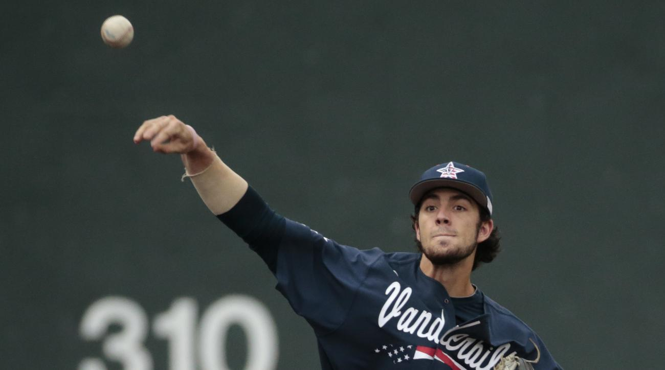 FILE - In this Monday, June 1, 2015, file photo, Vanderbilt shortstop Dansby Swanson throws the ball against Radford in an NCAA regional college baseball game in Nashville, Tenn.  Three Commodores--Swanson and pitchers Walker Buehler and Carson Fulmer--ar