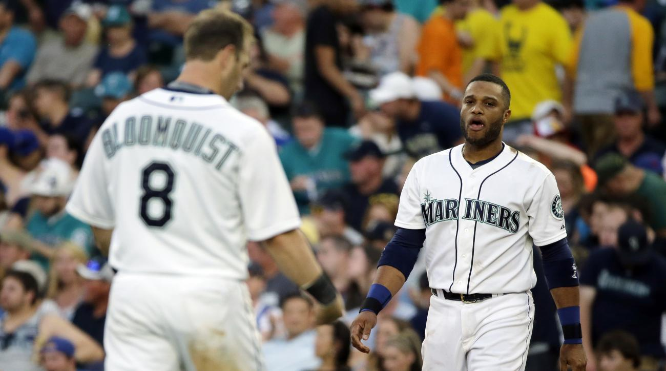 FILE - In this Saturday, June 6, 2015, file photo, Seattle Mariners' Robinson Cano, right, walks on the field after he grounded into a double play with the bases loaded to end the fourth inning of a baseball game against the Tampa Bay Rays. Mariners' Will