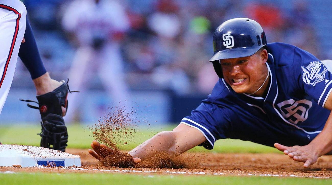 San Diego Padres' Will Venable is safe on a pickoff attempt by Atlanta Braves' Freddie Freeman during the second inning of a baseball game Monday, June 8, 2015, in Atlanta. (Curtis Compton/The Canadian Press via AP) MANDATORY CREDIT