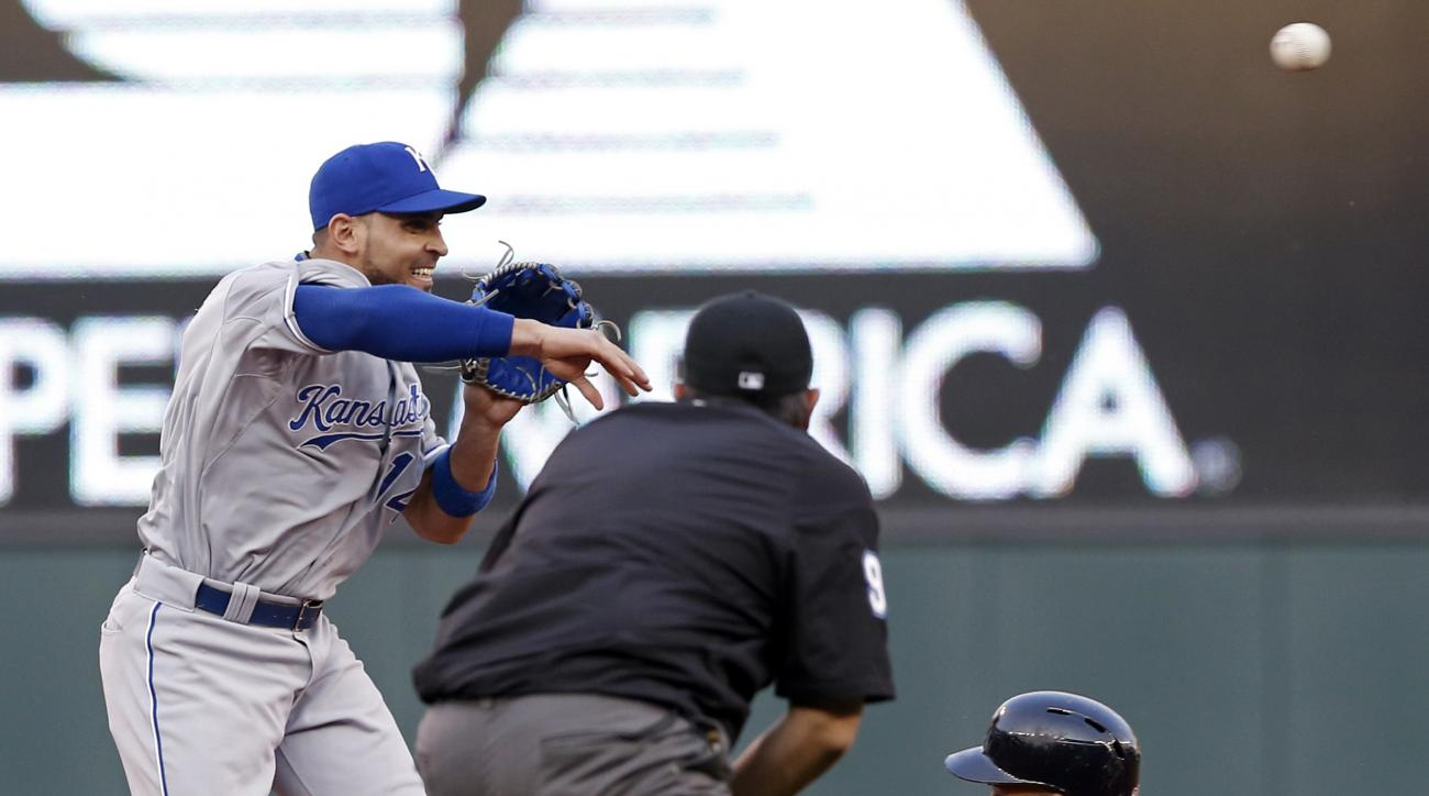 Minnesota Twins' Eddie Rosario, right, is out at second by Kansas City Royals second baseman Omar Infante on a fielders choice hit into by Lorenzo Cain in the third inning of a baseball game, Monday, June 8, 2015, in Minneapolis. (AP Photo/Jim Mone)
