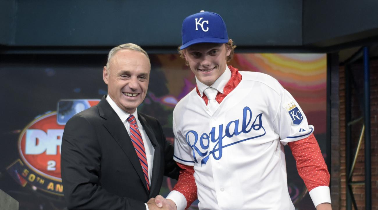 Commissioner of Major League Baseball Rob Manfred, left, poses with pitcher Ashe Russell from Cathedral High School in Indianapolis, Ind., at the 2015 MLB baseball draft Monday, June 8, 2015, in Secaucus, N.J. Whitley was chosen by the Kansas City Royals