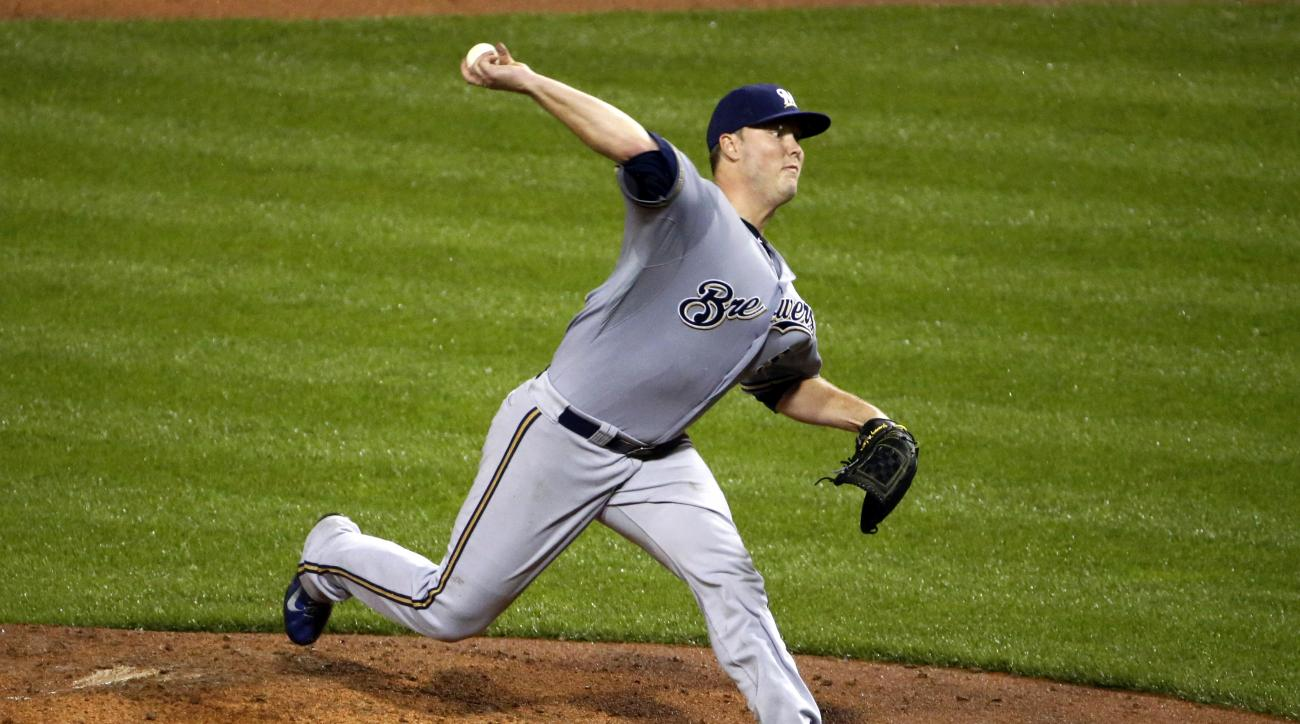 Milwaukee Brewers pitcher Jimmy Nelson (52) delivers in the sixth inning of a baseball game against the Pittsburgh Pirates in Pittsburgh, Monday, June 8, 2015. (AP Photo/Gene J. Puskar)
