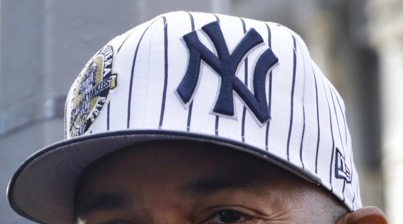 Former New York Yankees relief pitcher Mariano Rivera promotes New Era baseball caps featuring his jersey number, 42, Thursday, Nov. 21, 2013 in New York. Rivera retired at the end of the 2013 season. (AP Photo/Mark Lennihan)