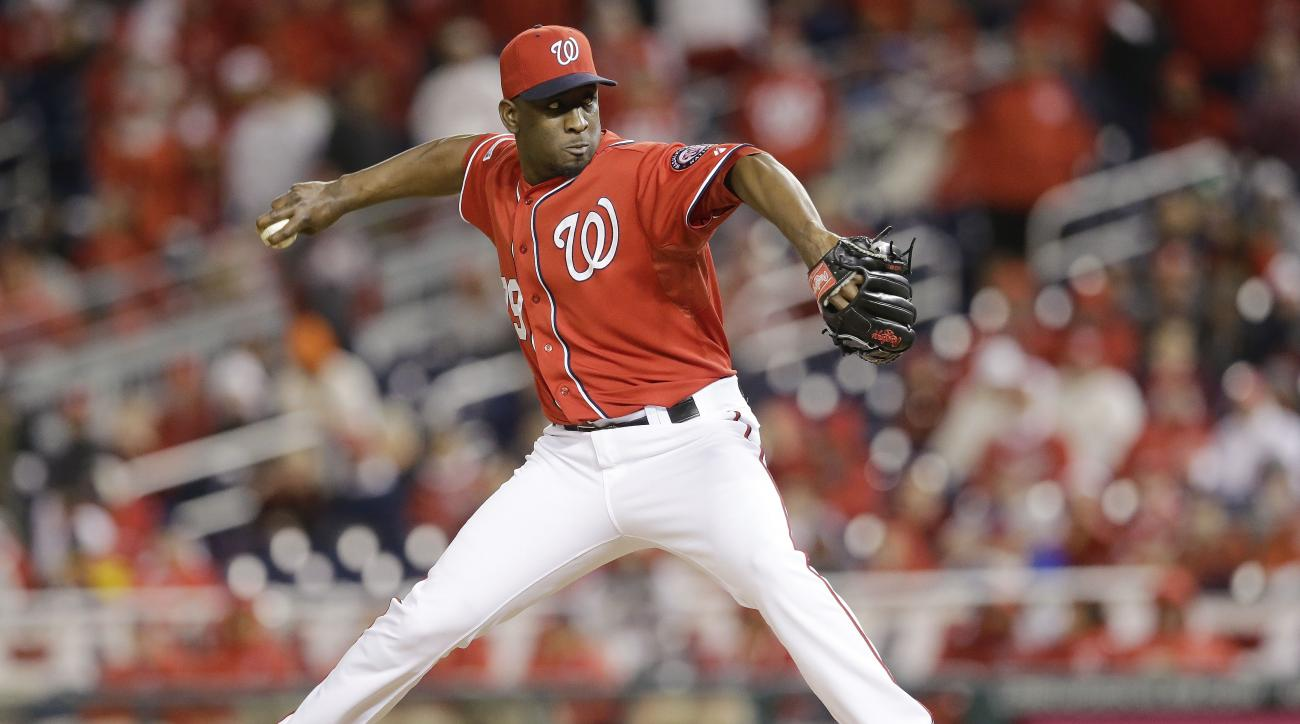 FILE - In this Oct. 4, 2014, file photo, Washington Nationals relief pitcher Rafael Soriano (29) throws in the 16th inning of Game 2 of baseball's NL Division Series against the San Francisco Giants in Nationals Park in Washington. The Chicago Cubs and fr