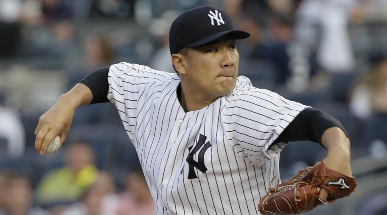 New York Yankees pitcher Masahiro Tanaka delivers against the Washington Nationals during the first inning of a baseball game, Tuesday, June 9, 2015, in New York. (AP Photo/Julie Jacobson)
