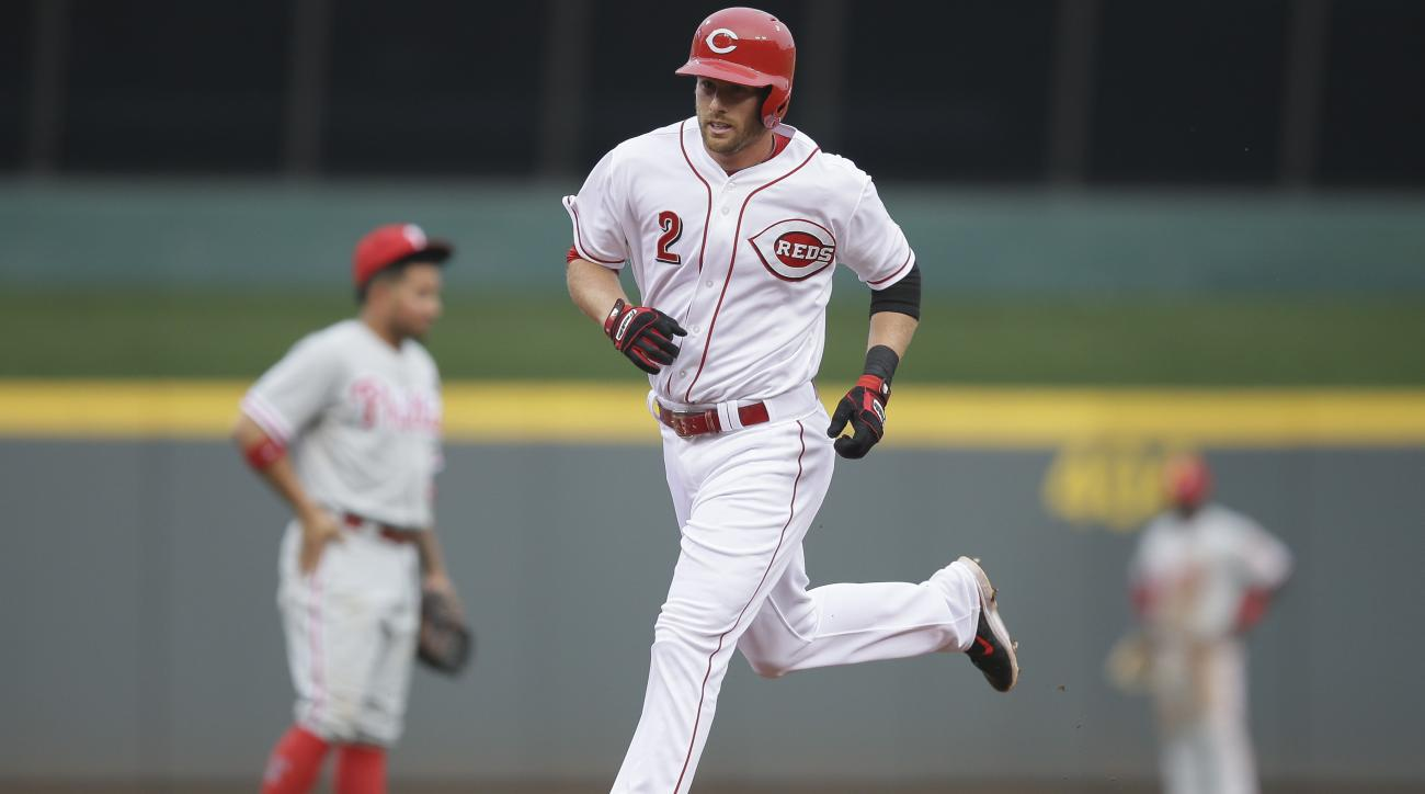 Cincinnati Reds' Zack Cozart rounds the bases after hitting a three-run home run off Philadelphia Phillies starting pitcher Aaron Harang during the first inning of a baseball game, Tuesday, June 9, 2015, in Cincinnati. (AP Photo/John Minchillo)