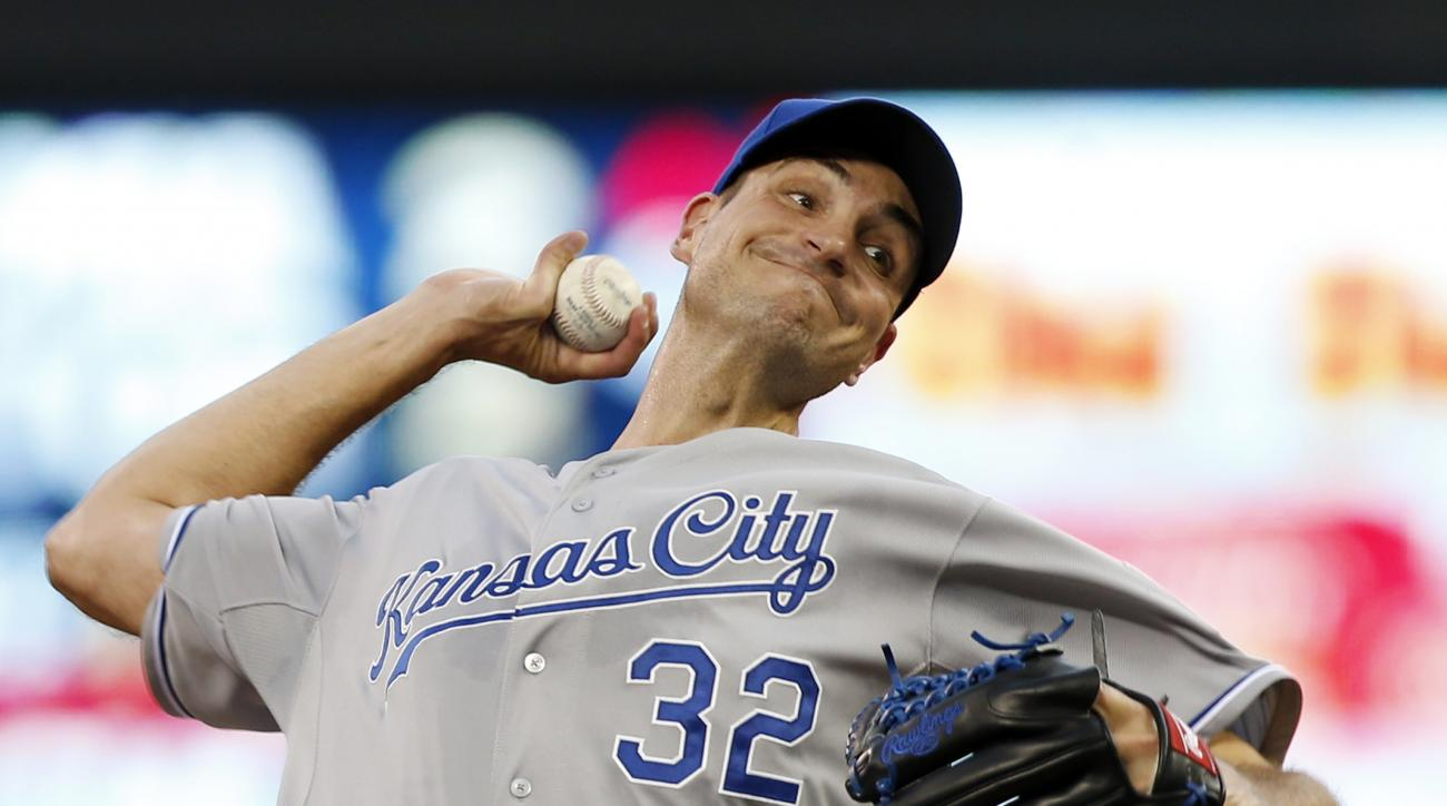 Kansas City Royals pitcher Chris Young throws against the Minnesota Twins during the first inning of a baseball game, Tuesday, June 9, 2015, in Minneapolis. (AP Photo/Jim Mone)
