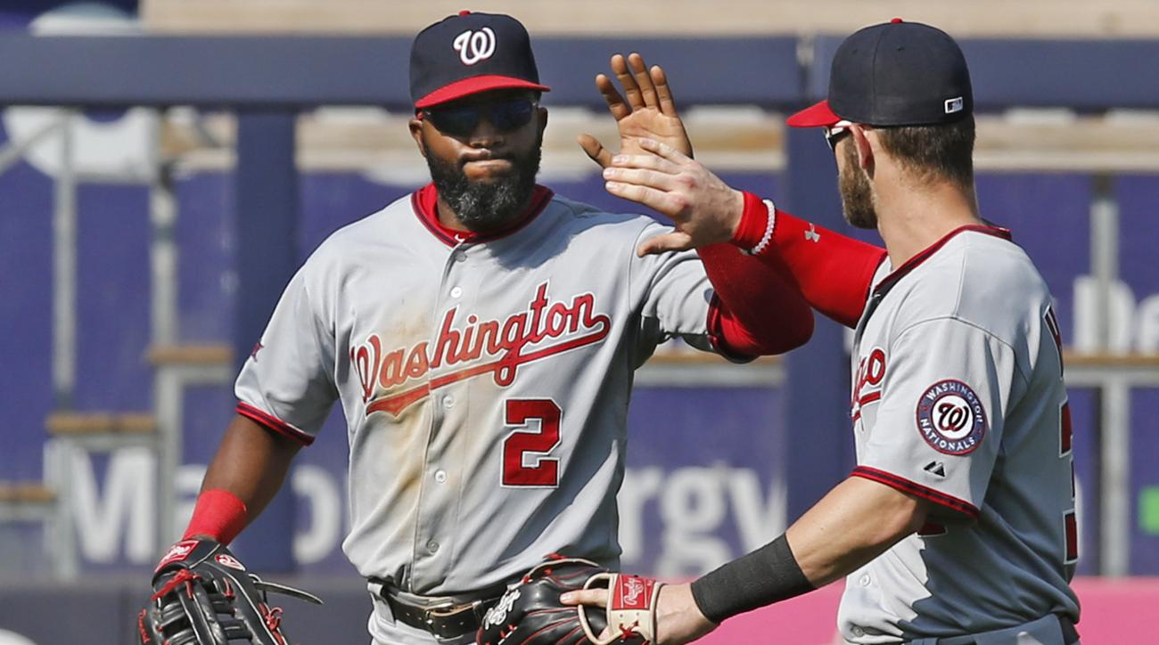 Washington Nationals right fielder Bryce Harper, right, celebrates with center fielder Denard Span (2) after their 5-4, 11-inning victory over the New York Yankees in a baseball game at Yankee Stadium in New York, Wednesday, June 10, 2015.  Span hit an 11