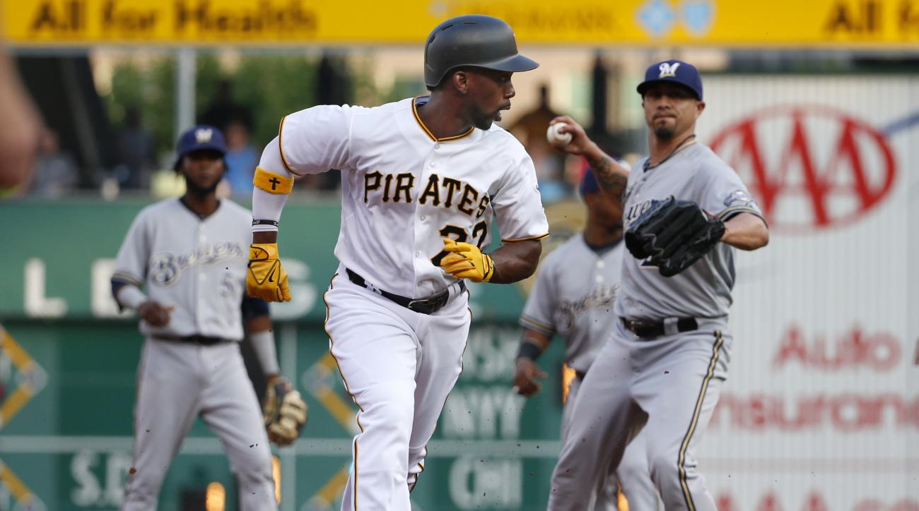 Pittsburgh Pirates' Andrew McCutchen, center, is caught in a rundown between second and third as starting pitcher Kyle Lohse, right, prepares to throw to third baseman Aramis Ramirez, who made the tag for the out in the first inning of a baseball game in
