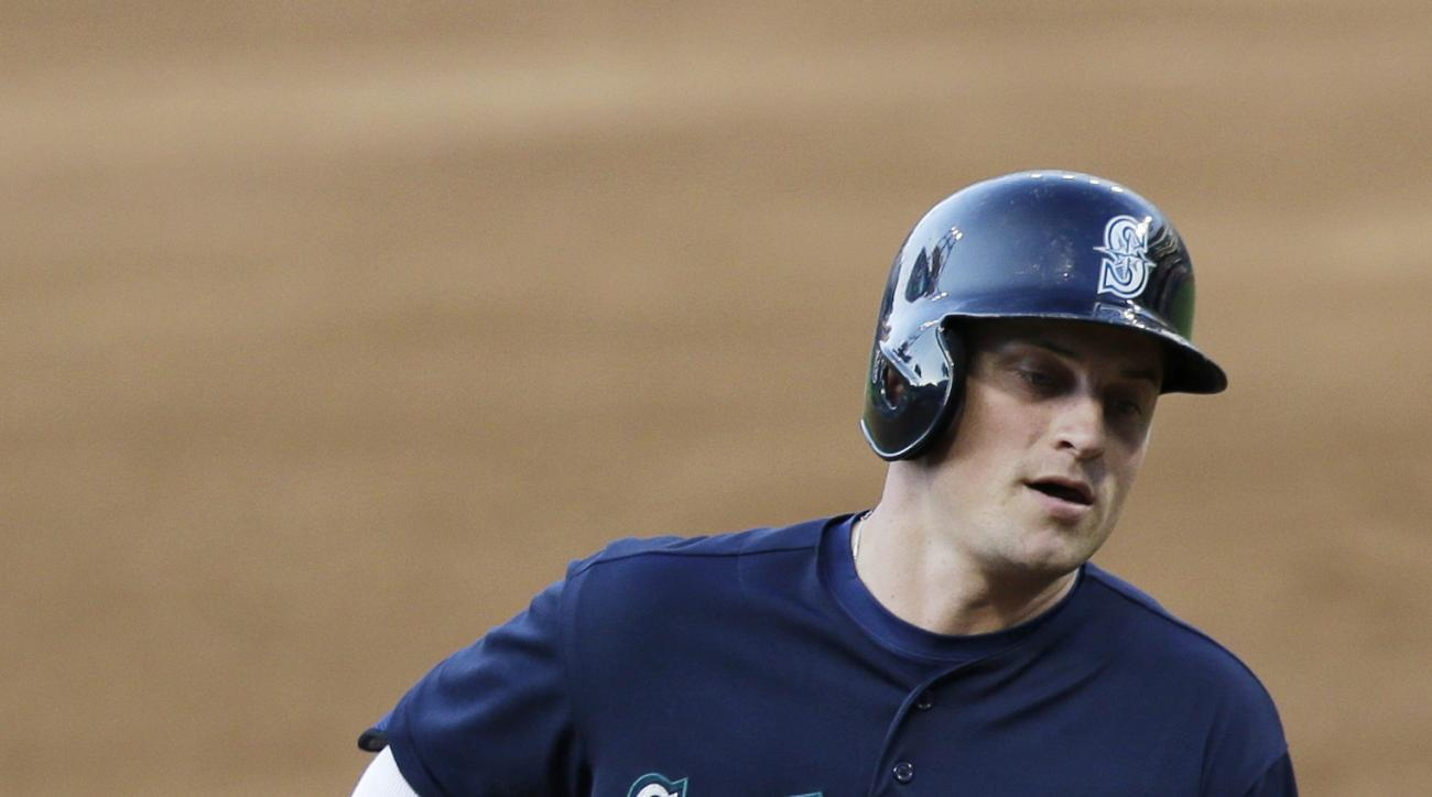 Seattle Mariners' Kyle Seager runs the bases after hitting a grand slam off Cleveland Indians starting pitcher Trevor Bauer during the third inning of a baseball game, Wednesday, June 10, 2015, in Cleveland. Mike Zunino, Austin Jackson and Robinson Cano s