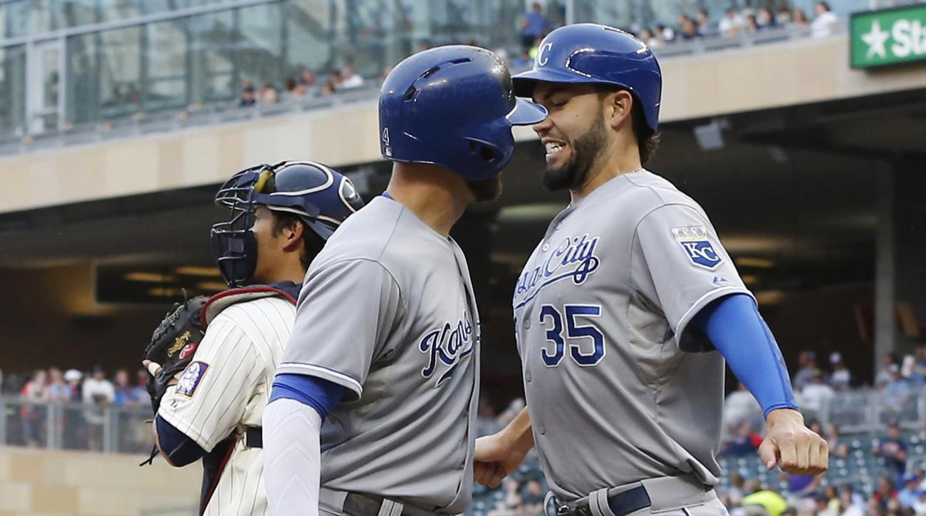 Kansas City Royals' Alex Gordon, left, and Eric Hosmer bump chests after Gordon's three-run home run off Minnesota Twins pitcher Kyle Gibson during the first inning of a baseball game, Wednesday, June 10, 2015, in Minneapolis. At left is Twins catcher Kur