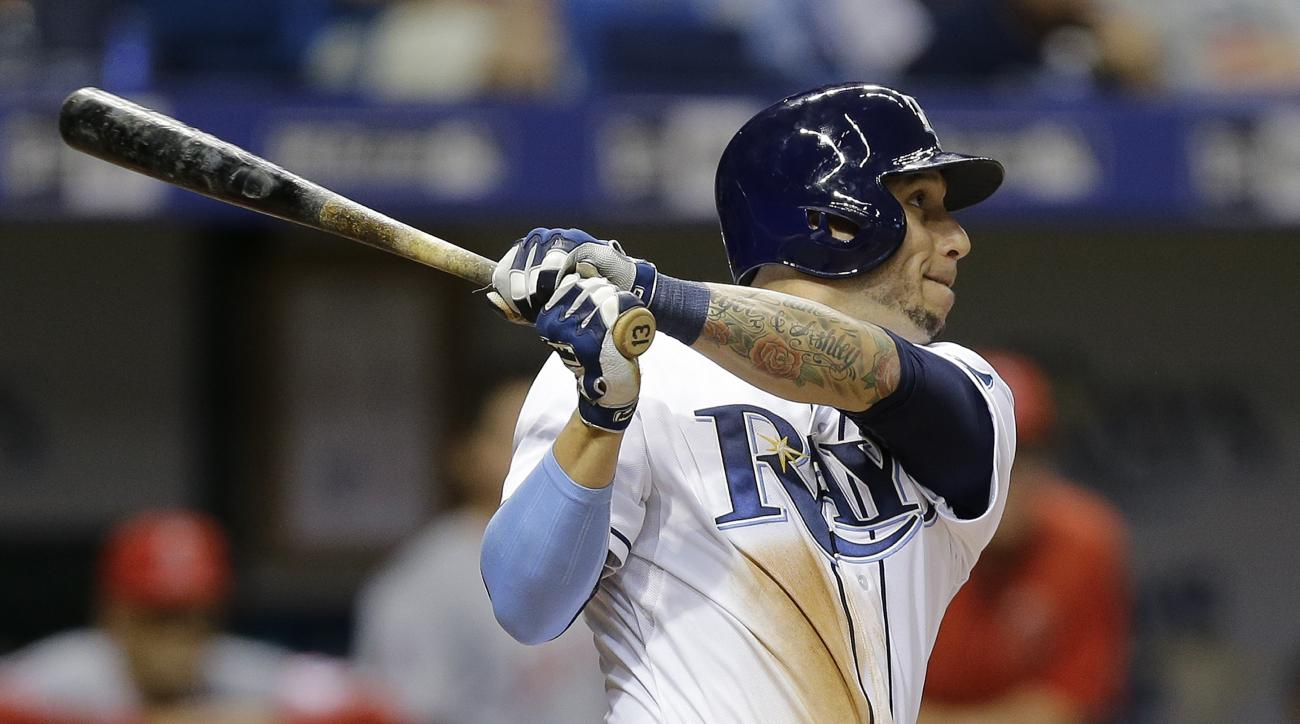 Tampa Bay Rays' Asdrubal Cabrera follows the flight of his RBI double off Los Angeles Angels relief pitcher Fernando Salas during the eighth inning of a baseball game Wednesday, June 10, 2015, in St. Petersburg, Fla.  Rays' Steven Souza Jr. scored on the