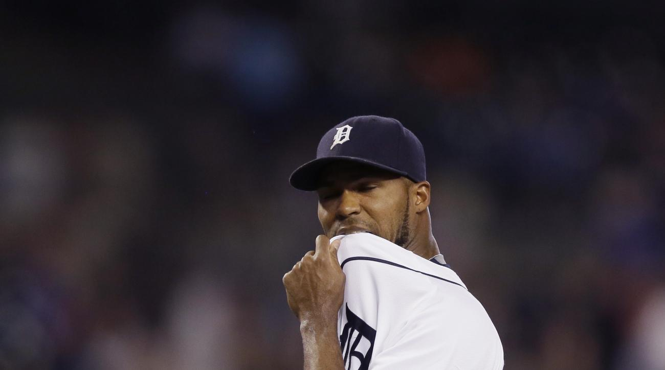 Detroit Tigers relief pitcher Al Alburquerque walks off the mound after giving up a three-run home run to Chicago Cubs' Miguel Montero during the seventh inning of a baseball game, Wednesday, June 10, 2015, in Detroit. (AP Photo/Carlos Osorio)