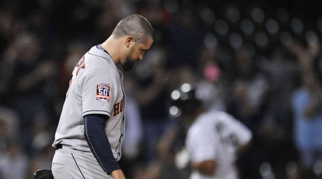 Houston Astros relief pitcher Pat Neshek reacts while Chicago White Sox's Jose Abreu rounds third base after hitting a two-run home run during the eighth inning of a baseball game Wednesday, June 10, 2015, in Chicago. (AP Photo/Paul Beaty)