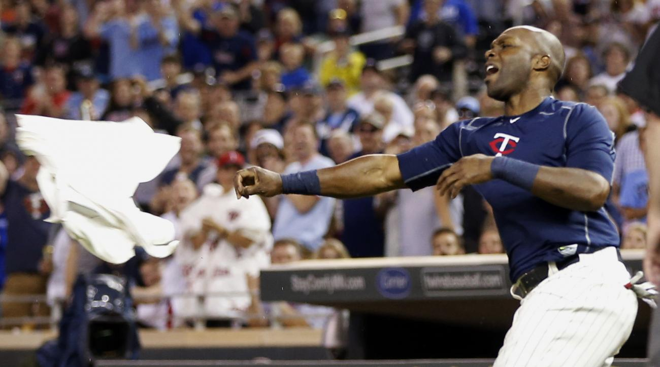 Minnesota Twins' Torii Hunter tosses his jersey following his ejection after he was called out on strikes in the eighth inning of a baseball game against the Kansas City Royals, Wednesday, June 10, 2015, in Minneapolis. The Royals won 7-2, sweeping the th