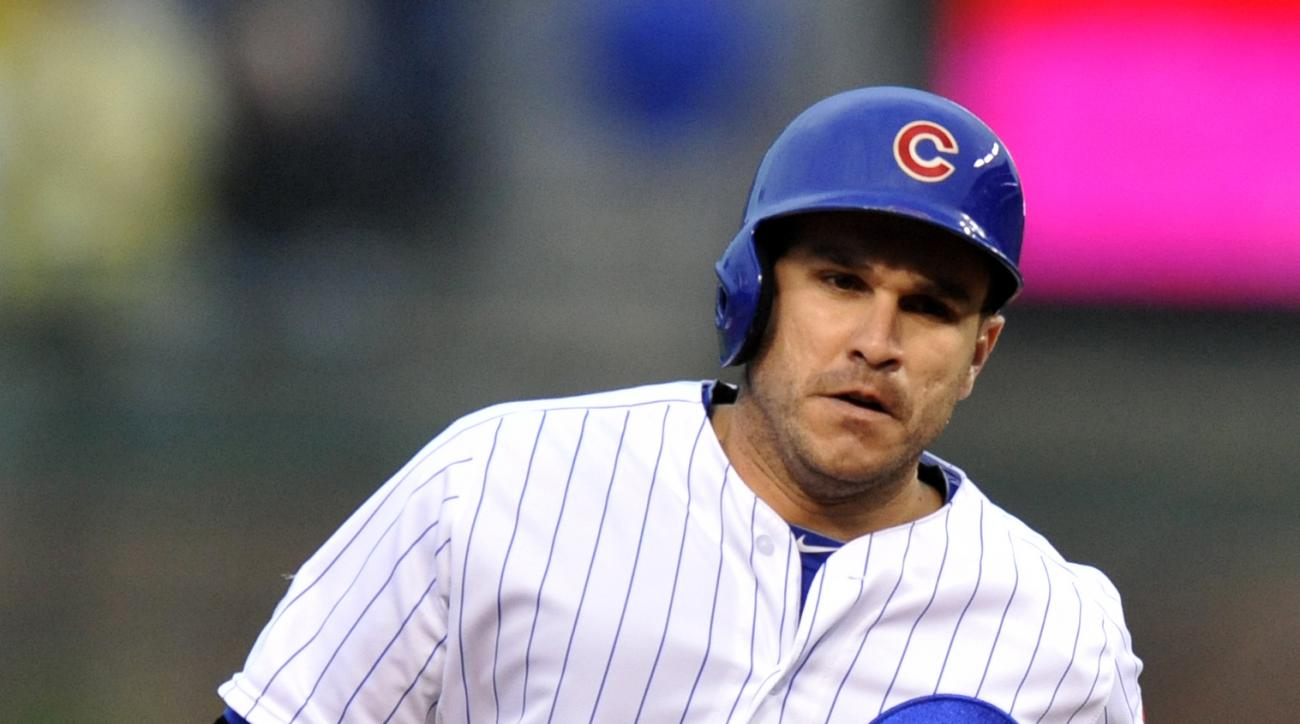 Chicago Cubs' Miguel Montero rounds the bases after hitting a three-run home run during the first inning of a baseball game against the Cincinnati Reds on Thursday, June 11, 2015 in Chicago. (AP Photo/Paul Beaty)