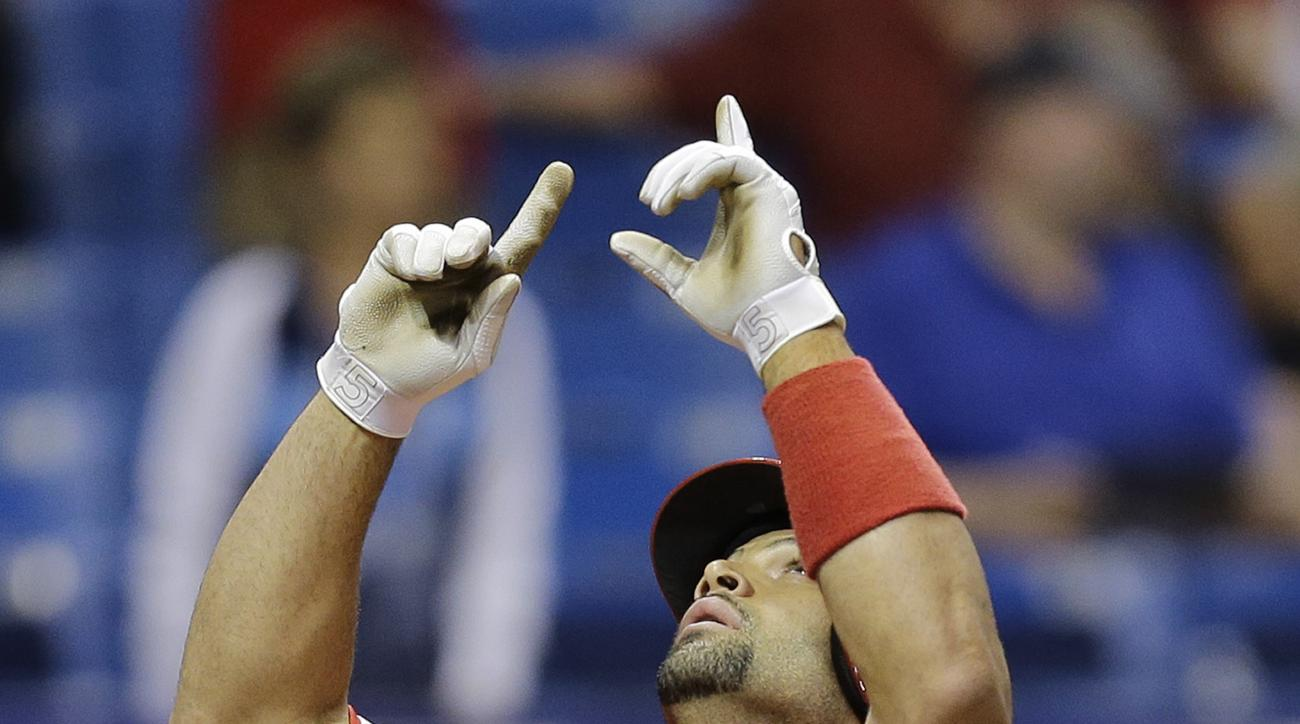 Los Angeles Angels' Albert Pujols gestures after his two-run home run off Tampa Bay Rays relief pitcher Preston Guilmet during the ninth inning of a baseball game Thursday, June 11, 2015, in St. Petersburg, Fla. (AP Photo/Chris O'Meara)
