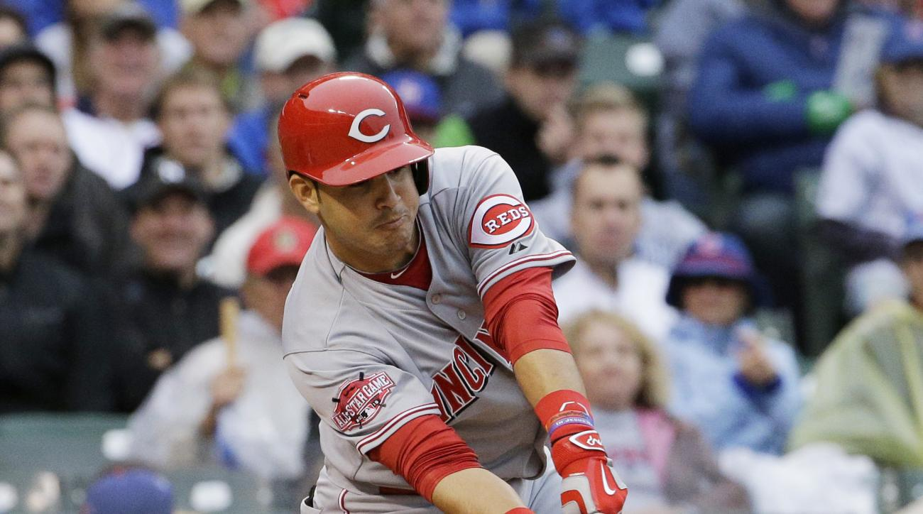 Cincinnati Reds' Eugenio Suarez hits an one-run single during the 10th inning of a baseball game against the Chicago Cubs, Friday, June 12, 2015, in Chicago. (AP Photo/Nam Y. Huh)